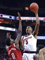 Louisville center Malik Williams (5) shoots over North Carolina State forward DJ Funderburk during the second half of an NCAA college basketball game in Louisville, Ky., Thursday, Jan. 24, 2019. Louisville won 84-77. (AP Photo/Timothy D. Easley)