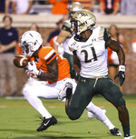 Virginia cornerback Nick Grant (1) intercepts a pass behind William & Mary wide receiver Jordan Lowery (21) during the first half of an NCAA college football game in Charlottesville, Va., Friday, Sept. 6, 2019. (AP Photo/Andrew Shurtleff)