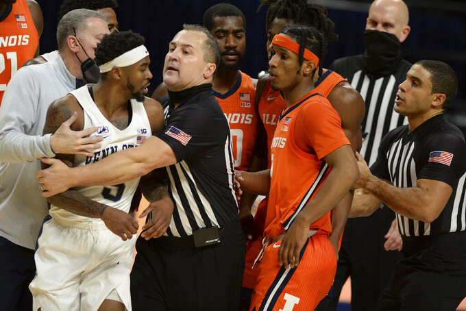 Penn State's Jamari Wheeler, left, and Illinois Ayo Dosunmu, right center, are separated in the final minute of an NCAA college basketball game Wednesday, Dec. 23, 2020, in State College, Pa. Among the players are Illinois' Da'Monte Williams (20) and Trent Frazier (1). (AP Photo/Gary M. Baranec)