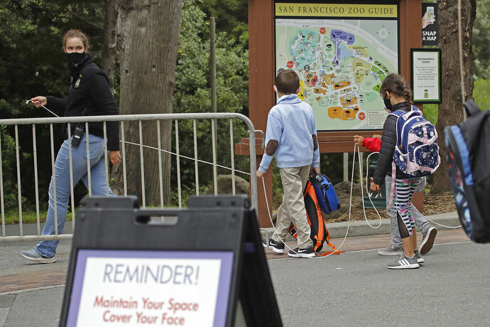 A class keeps social distance at the San Francisco Zoo on Monday, July 13, 2020, in San Francisco. (AP Photo/Ben Margot)