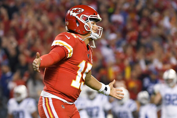 Kansas City Chiefs quarterback Patrick Mahomes celebrates after throwing a touchdown pass to wide receiver Byron Pringle during the first half of an NFL football game against the Indianapolis Colts in Kansas City, Mo., Sunday, Oct. 6, 2019. (AP Photo/Reed Hoffmann)