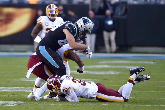 Carolina Panthers tight end Greg Olsen is hit by Washington Redskins linebacker Ryan Anderson, rear, and cornerback Fabian Moreau (31) during the second half of an NFL football game in Charlotte, N.C., Sunday, Dec. 1, 2019. Olsen was injured on the play, Anderson was disqualified for the remainder of the game. (AP Photo/Mike McCarn)