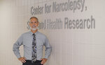Researcher David Carley of the University of Illinois at Chicago poses for a photo at the school on May 31, 2018. A small experiment in 73 people suggests dronabinol, which contains THC, helps some with sleep apnea, but wasn't completely effective. It may work better in combination with CPAP or other devices, Carley says. (AP Photo/Teresa Crawford)