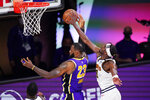 Denver Nuggets' Jerami Grant (9) blocks a shot by Los Angeles Lakers' LeBron James (23) during the second half of an NBA conference final playoff basketball game Saturday, Sept. 26, 2020, in Lake Buena Vista, Fla. (AP Photo/Mark J. Terrill)