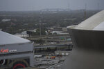 Through the morning rain the Huey P Long Bridge can be seen between the Caesars Superdome and the Smoothie King Center as Hurricane Ida approaches the Louisiana coast in New Orleans, La. Sunday, Aug. 29, 2021. (Max Becherer/The Advocate via AP)