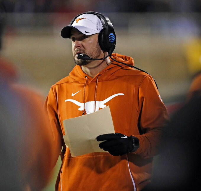 Texas coach Tom Herman walks down the sideline during the first half of the team's NCAA college football game against Texas Tech, Saturday, Nov. 10, 2018, in Lubbock, Texas. (AP Photo/Brad Tollefson)