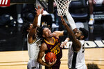 Minnesota forward Brandon Johnson (23) tries to shoots between Purdue forward Trevion Williams (50) and guard Jaden Ivey (23 during the first half of an NCAA college basketball game in West Lafayette, Ind., Saturday, Jan. 30, 2021. (AP Photo/Michael Conroy)