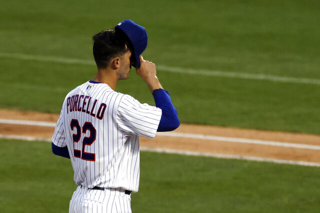New York Mets pitcher Rick Porcello reacts during the third inning of the team's baseball game against the Atlanta Braves on Sunday, July 26, 2020, in New York. (AP Photo/Adam Hunger)