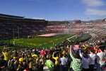 FILE - In this Jan. 1, 2020, file photo, fans stand for the national anthem before the Rose Bowl NCAA college football game between Oregon and Wisconsin in Pasadena, Calif. No spectators will be allowed at the Rose Bowl for the College Football Playoff semifinal on Jan. 1 because of COVID-19 restrictions imposed by the state, county and city of Pasadena, The Tournament of Roses said Thursday, Dec. 3, 2020. (AP Photo/Mark J. Terrill, File)