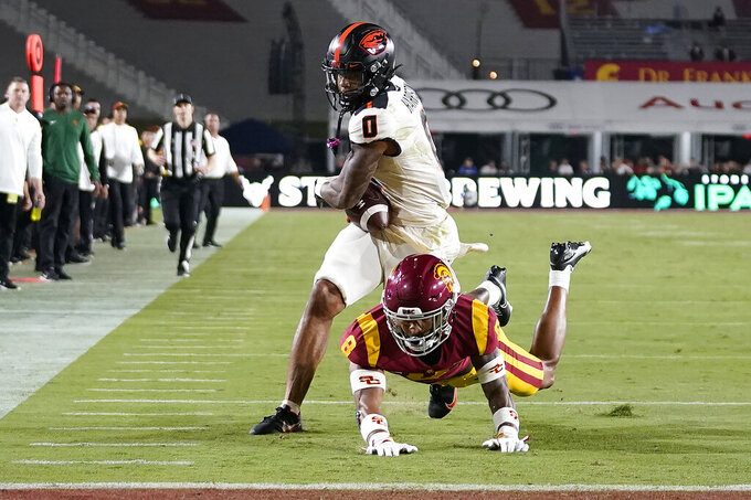 Oregon State wide receiver Tre'Shaun Harrison (0) catches a touchdown pass Southern California cornerback Chris Steele (8) during the first half of an NCAA college football game Saturday, Sept. 25, 2021, in Los Angeles. (AP Photo/Marcio Jose Sanchez)