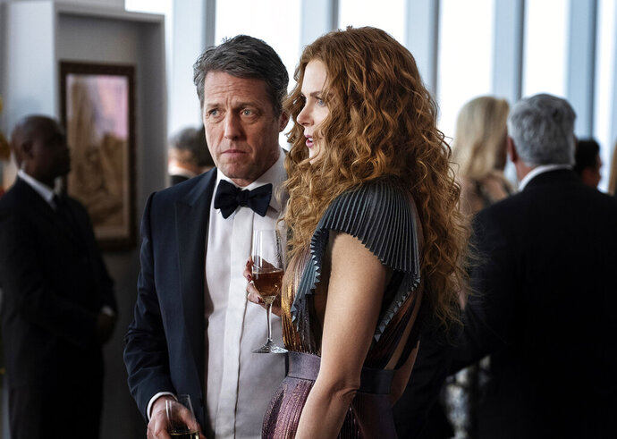 This image released by HBO shows Hugh Grant, left, and Nicole Kidman in a scene from