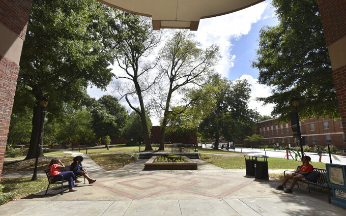 Students sit on the campus of Spelman College on Sept. 26, 2018, in Atlanta. Several historically Black colleges and universities, including Spelman College, will receive more than $650,000 in grants to preserve their campuses as part of a new initiative announced Tuesday, Feb. 16, 2021. (Hyosub Shin/Atlanta Journal-Constitution via AP)