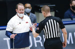Mississippi head coach Kermit Davis, left, argues a call during the second half of an NCAA college basketball game against Louisiana Tech in the NIT, Friday, March 19, 2021, in Frisco, Texas. (AP Photo/Brandon Wade)