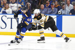 St. Louis Blues center Ivan Barbashev (49), of Russia, moves the puck ahead of Boston Bruins left wing Marcus Johansson (90), of Sweden, during the third period of Game 3 of the NHL hockey Stanley Cup Final Saturday, June 1, 2019, in St. Louis. The Bruins won 7-2 and lead the series 2-1. (AP Photo/Jeff Roberson)