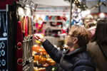 FILE - In this Dec. 6, 2019, file photo people shop at Christkindlmarkt in Bethlehem, Pa. On Thursday, Jan. 16, 2020, the Commerce Department releases U.S. retail sales data for December. (AP Photo/Matt Rourke, File)