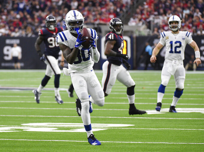 Indianapolis Colts wide receiver Chester Rogers (80) pulls in a pass from quarterback Andrew Luck (12) during the first half of an NFL wild card playoff football game against the Houston Texans, Saturday, Jan. 5, 2019, in Houston. (AP Photo/Eric Christian Smith)