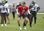 New York Jets first round draft pick Zach Wilson works out during NFL football rookie camp, Friday, May 7, 2021, in Florham Park, N.J.(AP Photo/Bill Kostroun)