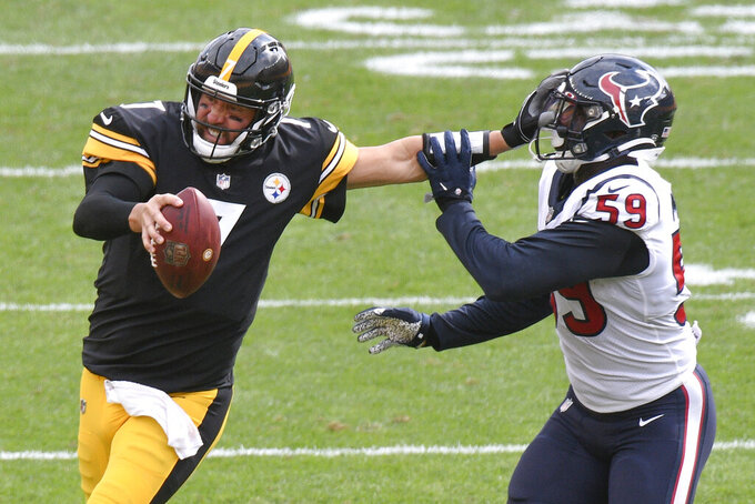 Pittsburgh Steelers quarterback Ben Roethlisberger (7) stiff-arms Houston Texans outside linebacker Whitney Mercilus (59) while trying to scramble for a first down in the second half of an NFL football game, Sunday, Sept. 27, 2020, in Pittsburgh. The Steelers did not get the first down. (AP Photo/Don Wright)