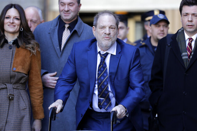 Harvey Weinstein, center, leaves a Manhattan courthouse after closing arguments in his rape trial in New York, Friday, Feb. 14, 2020. (AP Photo/Seth Wenig)