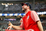 Injured Washington Nationals pitcher Max Scherzer jokes with Atlanta Braves third baseman Josh Donaldson from the dugout during a baseball game Friday, July 19, 2019, in Atlanta. The three-time Cy Young Award winner, will not come off the 10-day injured list to start for Washington against Atlanta this weekend. (AP Photo/John Bazemore)