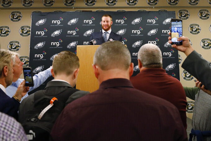 Philadelphia Eagles quarterback Carson Wentz speaks during a news conference following the team's NFL football game against the Green Bay Packers on Thursday, Sept. 26, 2019, in Green Bay, Wis. Philadelphia won 34-27. (AP Photo/Jeffrey Phelps)