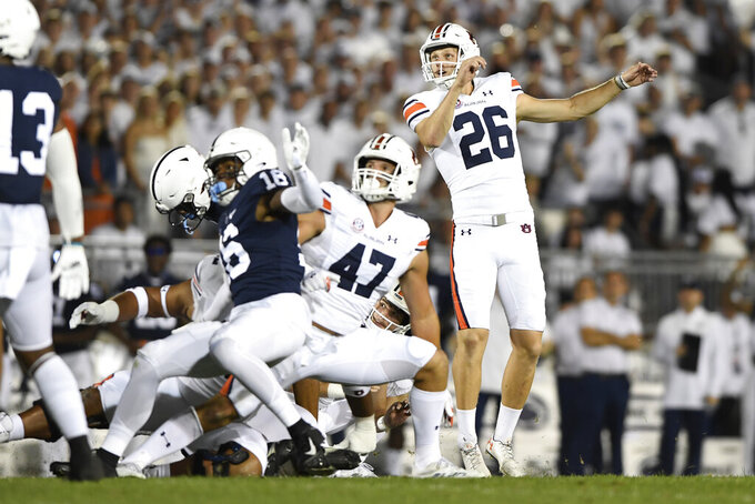 Auburn kicker Anders Carlson (26) kicks a field goal against Penn State during the first half of an NCAA college football game in State College, Pa., on Saturday, Sept.18, 2021. (AP Photo/Barry Reeger)