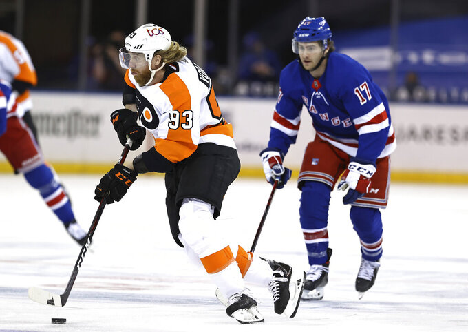 Philadelphia Flyers' Jakub Voracek (93) takes the puck as New York Rangers' Kevin Rooney (17) defends in the first period of an NHL hockey game Thursday, April 22, 2021, in New York. (Elsa/Pool Photo via AP)