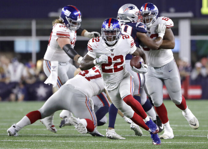 FILE - In this Aug. 29, 2019, file photo, New York Giants running back Wayne Gallman (22) carries the ball against the New England Patriots during the second half of a preseason NFL football game in Foxborough, Mass. With Saquon Barkley out with a sprained right ankle, Gallman is going to start Sunday against the Washington Redskins at MetLife Stadium. (AP Photo/Steven Senne, File)