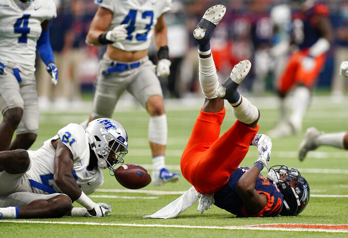 UTSA running back Sincere McCormick (3) is upended by Middle Tennessee cornerback Kenneth Major (21) during the first half of an NCAA college football game, Friday, Sept. 25, 2020, in San Antonio. The ball was ruled dead on the play and UTSA kept possession. (AP Photo/Eric Gay)
