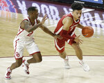 Alabama's Jaden Shackelford (5) goes against Oklahoma's Umoja Gibson (2) during the first half of an NCAA college basketball game in Norman, Okla., Saturday, Jan. 30, 2021. (AP Photo/Garett Fisbeck)
