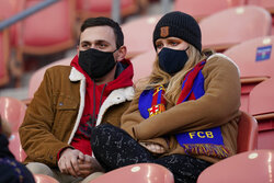 Real Salt Lake fans wearing masks wait for the team's MLS soccer match against Los Angeles FC on Wednesday, Sept. 9, 2020, in Sandy, Utah. (AP Photo/Rick Bowmer)
