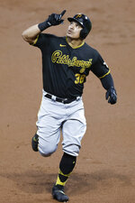 Pittsburgh Pirates' Jose Osuna celebrates as he rounds the bases after hitting a solo home run off Cleveland Indians pitcher Aaron Civale during the second inning of a baseball game, Saturday, Sept. 26, 2020, in Cleveland. (AP Photo/Ron Schwane)