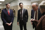 David Daleiden, second from left, and Sandra Merritt, right, talk with Daleiden's attorneys Peter Breen, left, and Thomas Brejcha outside of a courtroom in San Francisco, Monday, Feb. 11, 2019. Planned Parenthood has made an unusual legal demand to join California's criminal prosecution of two anti-abortion activists charged with invasion of privacy for secretly making videos as they tried to buy fetal material from the organization.(AP Photo/Jeff Chiu)
