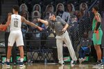 Georgia Tech head coach Josh Pastner, center, instructs his team during the first half of an NCAA college basketball game against Florida A&M in Atlanta, Friday, Dec. 18, 2020. (Alyssa Pointer/Atlanta Journal-Constitution via AP)