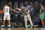 Georgia Tech head coach Josh Pastner, center, instructs his team during the first half of an NCAA college basketball game against Florida A&M in Atlanta, Friday, Dec. 18, 2020. (Alyssa Pointer/Atlanta Journal-Constitution via AP)