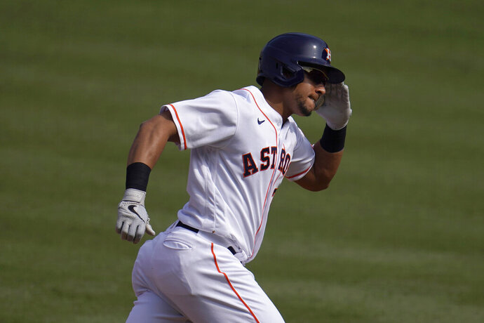 FILE - In this Oct. 8, 2020, file photo, Houston Astros' Michael Brantley gestures while rounding the bases on his two-run home run against the Oakland Athletics during the fourth inning of Game 4 of a baseball American League Division Series in Los Angeles. Brantley has agreed to a $32 million, two-year contract with the Astros, a person familiar with the deal told The Associated Press. The person spoke to the AP on condition of anonymity Wednesday, Jan. 20, because the contract, which is pending a successful physical, had not been announced. (AP Photo/Marcio Jose Sanchez, File)