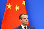 French President Emmanuel Macron looks on as he speaks at a China-France Economic Forum at the Great Hall of the People in Beijing, Wednesday, Nov. 6, 2019. (Florence Lo/Pool Photo via AP)