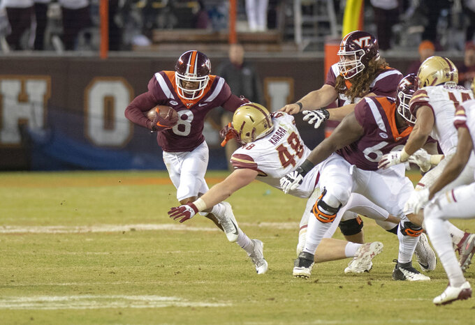 Virginia Tech wide receiver Phil Patterson avoids the tackle by Boston College defensive tackle Tanner Karafa during an NCAA college football game in Blacksburg, Va., Saturday, Nov. 3, 2018. (AP Photo/Matt Bell)