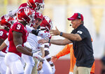 Indiana head coach Tom Allen greets players as they head to the bench during the second half of an NCAA college football game against Eastern Illinois, Saturday, Sept. 7, 2019, in Bloomington, Ind. Indiana won 52-0. (AP Photo/Doug McSchooler)