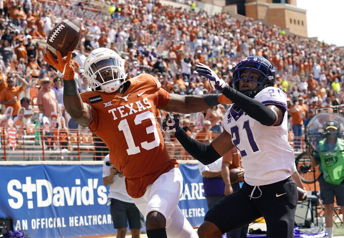 TCU cornerback Noah Daniels (21) breaks up a pass intended for Texas wide receiver Brennan Eagles (13) during the second half of an NCAA college football game, Saturday, Oct. 3, 2020, in Austin, Texas. (AP Photo/Eric Gay)