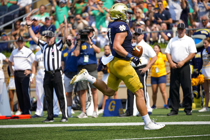 Notre Dame tight end Michael Mayer scores a touchdown in the first half against Toledo during an NCAA college football game in South Bend, Ind., Saturday, Sept. 11, 2021. (AP Photo/AJ Mast)