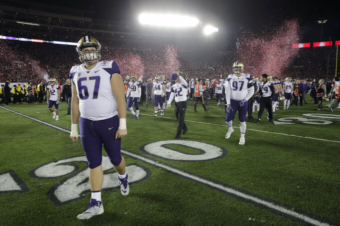 Washington players leav the field after their28-23 loss to Ohio State during the Rose Bowl NCAA college football game Tuesday, Jan. 1, 2019, in Pasadena, Calif. (AP Photo/Jae C. Hong)