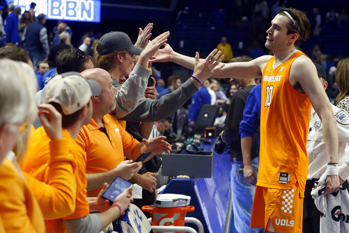 Tennessee's John Fulkerson (10) greets fans after Tennessee defeated Kentucky 81-73 in an NCAA college basketball game Tuesday, March 3, 2020, in Lexington, Ky. (AP Photo/James Crisp)