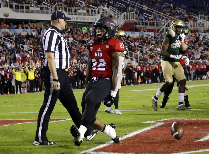 Northern Illinois running back Tre Harbison (22) reacts after scoring a touchdown during the first half of the Boca Raton Bowl NCAA college football game against UAB, Tuesday, Dec. 18, 2018, in Boca Raton, Fla. (AP Photo/Lynne Sladky)