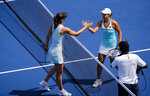 Ashleigh Barty, right, of Australia shakes hands with Maria Sharapova, of Russia, after their match at the Western & Southern Open tennis tournament Wednesday, Aug. 14, 2019. in Mason, Ohio. (Meg Vogel/The Cincinnati Enquirer via AP)