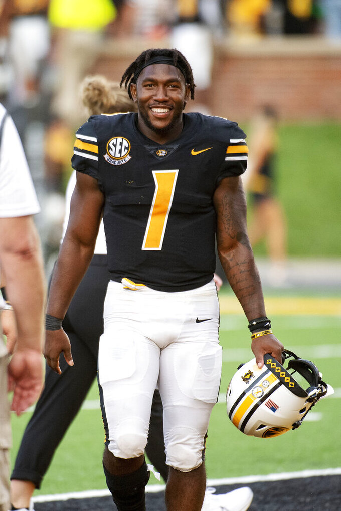Missouri running back Tyler Badie smiles as he walks off the field after defeating Central Michigan in an NCAA college football game Saturday, Sept. 4, 2021, in Columbia, Mo. (AP Photo/L.G. Patterson)
