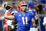 FILE - Florida quarterback Kyle Trask (11) throws a pass against South Carolina during the first half of an NCAA college football game in Gainesville, Fla., in this Saturday, Oct. 3, 2020, file photo. No. 6 Florida doesn't really even try to run the ball anymore. There's an occasional handoff here and there, but the Gators are mostly one-dimensional _ and that's fine with coach Dan Mullen, Heisman Trophy front-runner Kyle Trask and arguably the deepest receiving corps in the country. (AP Photo/John Raoux, File)