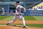 Los Angeles Dodgers starting pitcher Walker Buehler throws to the plate during the first inning of a baseball game against the Texas Rangers Sunday, June 13, 2021, in Los Angeles. (AP Photo/Mark J. Terrill)