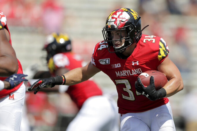 FILE - In this Aug. 31, 2019, file photo, Maryland running back Jake Funk runs with the ball against Howard during the second half of an NCAA college football game in College Park, Md. Funk and Tayon Fleet-Davis will likely receive the brunt of the carries, at least at the season's outset. Fleet-Davis, a senior, has 589 yards in offense and 10 touchdowns. Funk has 31 games of experience despite missing the final nine games in 2019 with a knee injury. Moreover, as Locksley enters his second season as the helm, he deals with quarterback Josh Jackson opting out of the 2020 season because of the COVID-19 pandemic and Tyrrell Pigrome has transferred to Western Kentucky. Alabama transfer Taulia Tagovailoa and redshirt freshman Lance Legendre have been competing for the starting spot this fall. (AP Photo/Julio Cortez, File)
