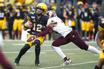 Appalachian State quarterback Zac Thomas (12) is hit by Texas State safety Jalen Smith (24) during the first half of an NCAA college football game Saturday, Nov. 23, 2019, in Boone, N.C. (AP Photo/Brian Blanco)